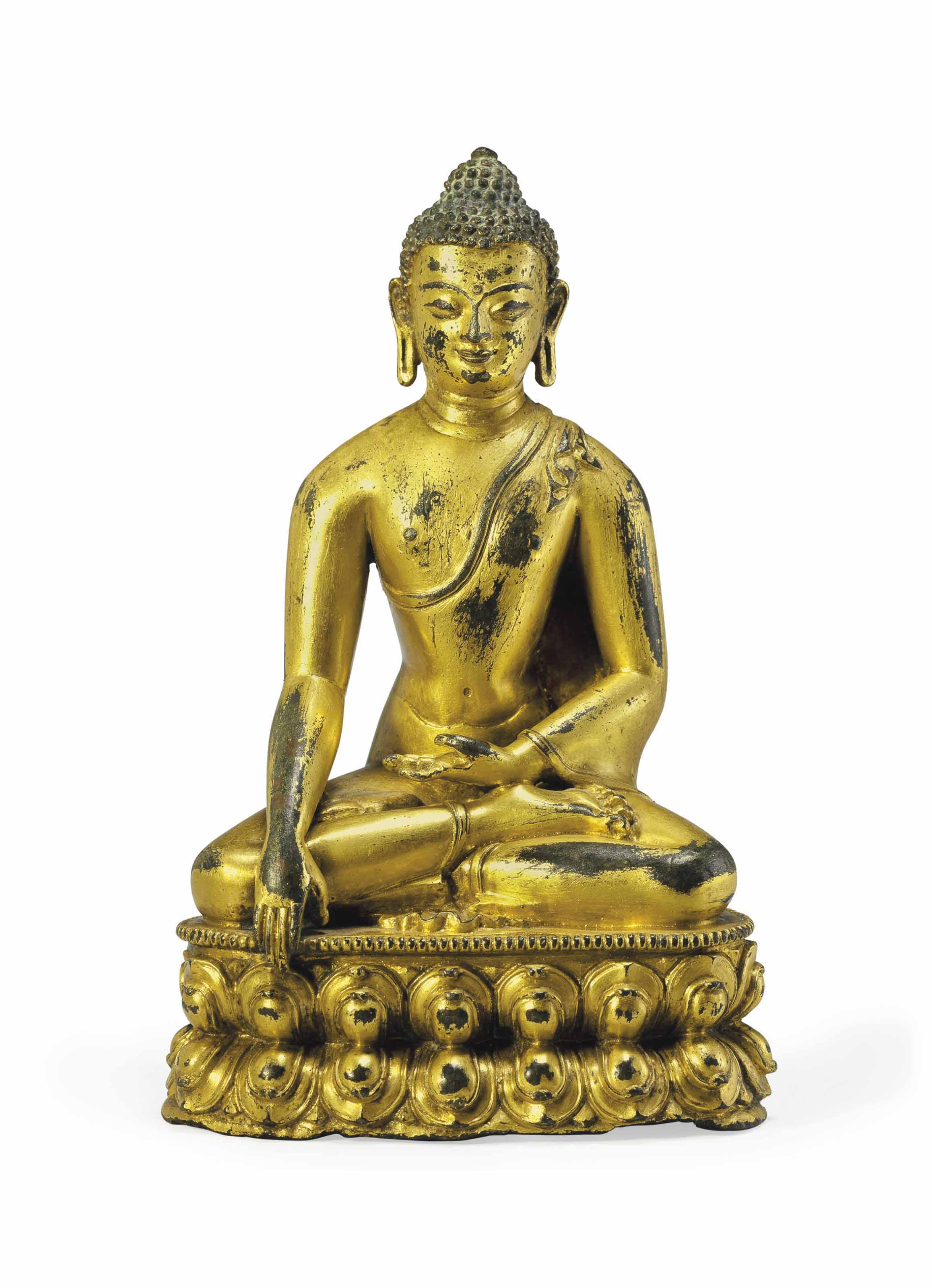 A gilt copper figure of Buddha