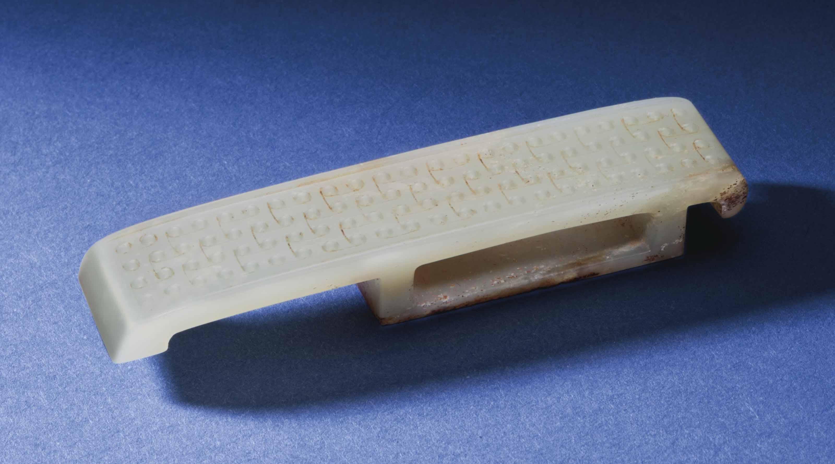 A WHITE JADE SCABBARD SLIDE