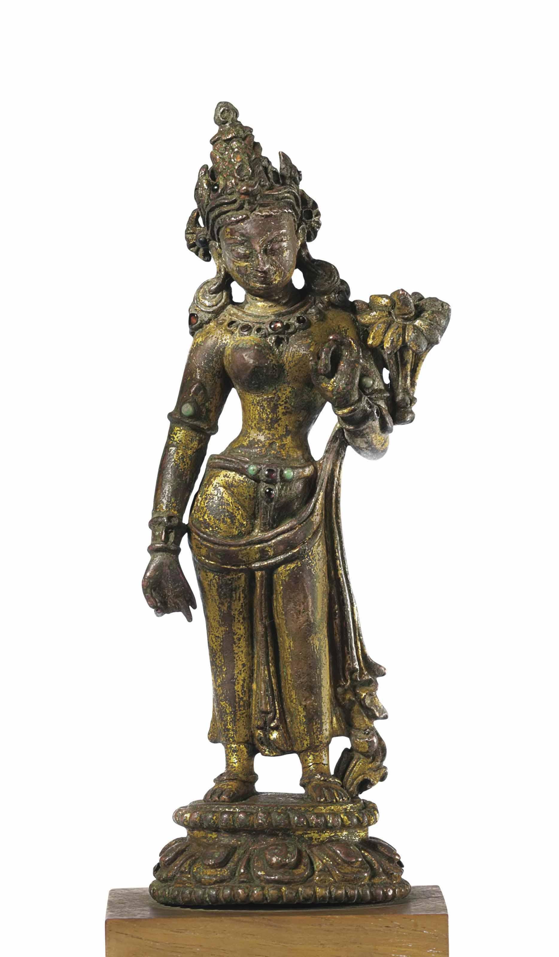 A Gilt Bronze Figure of a Stan