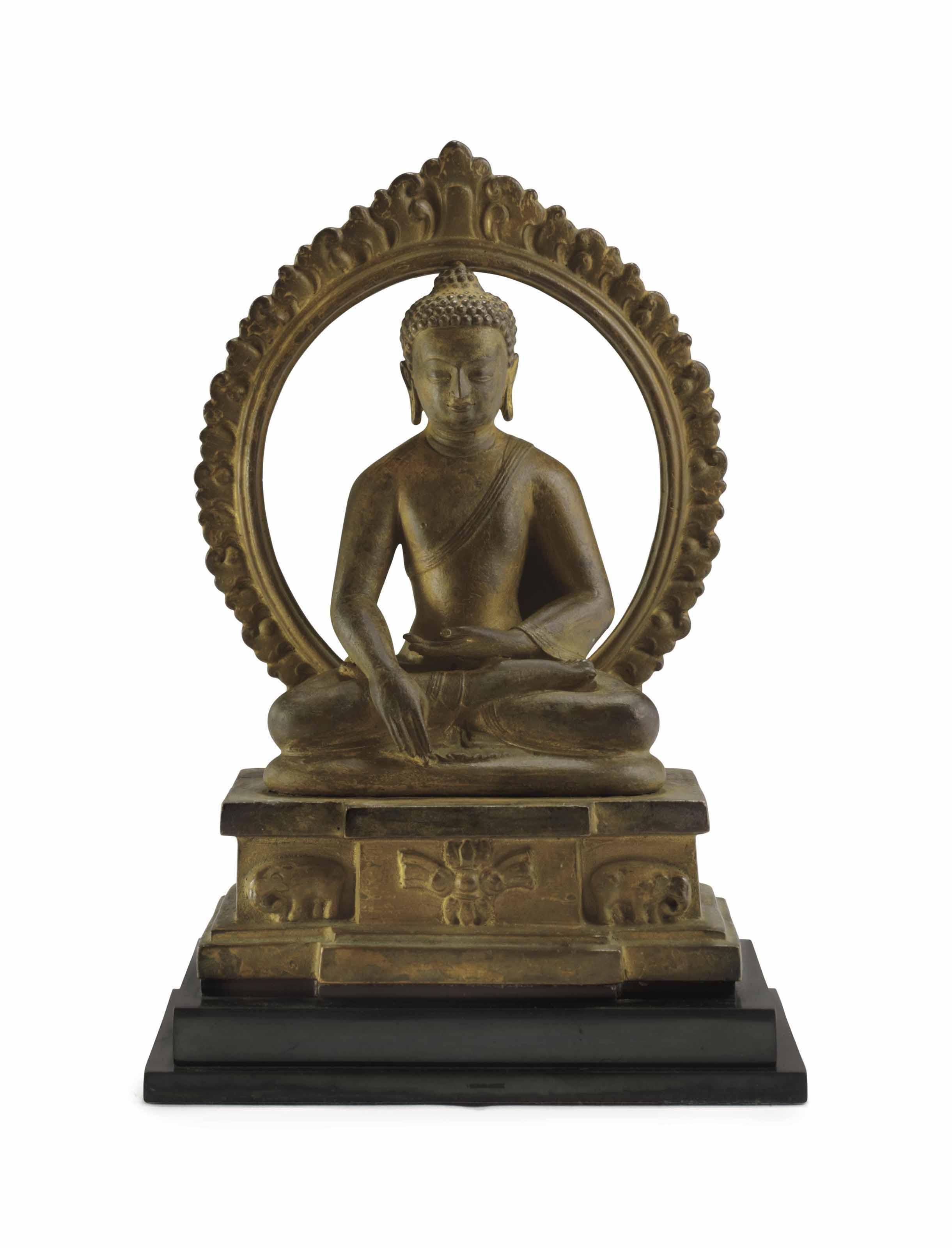 A Bronze Figure of an Enthrone