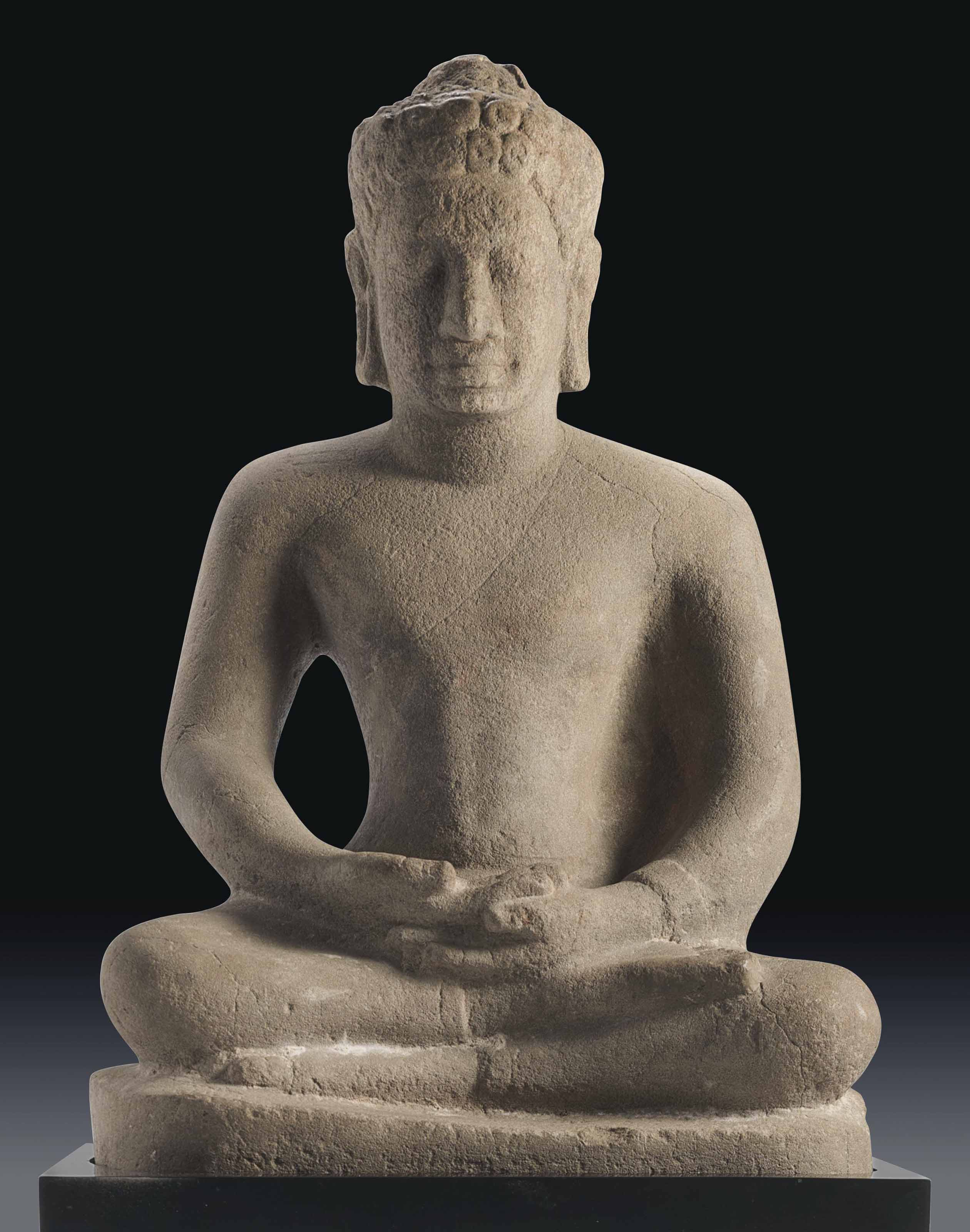 A Sandstone Figure of a Seated