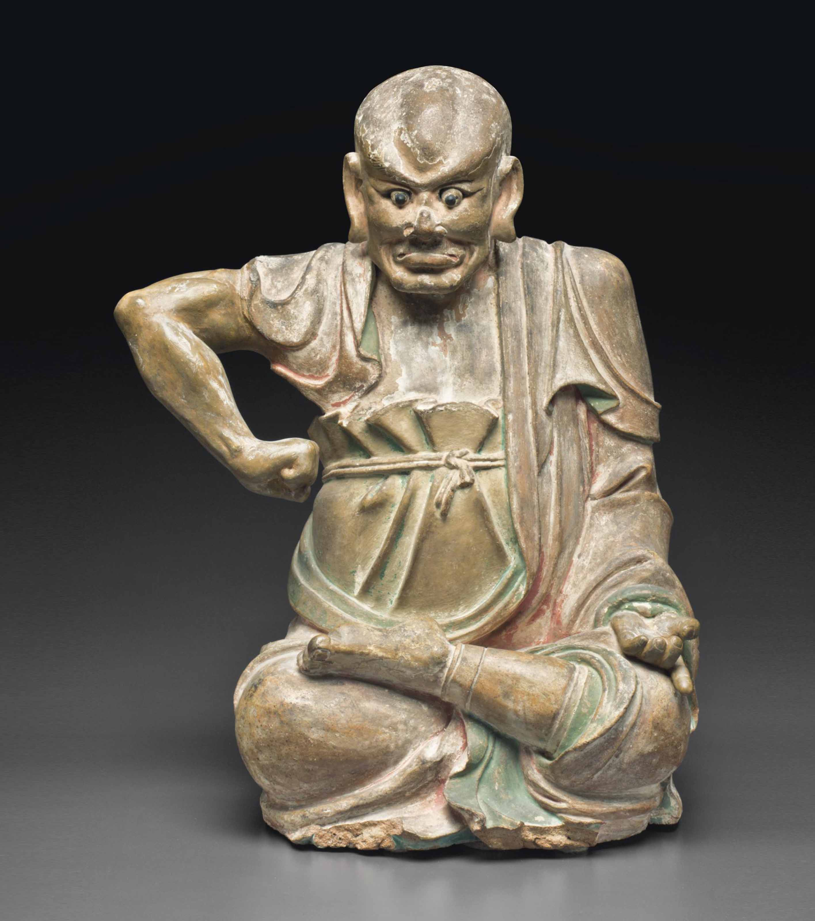 A PAINTED STONEWARE FIGURE OF