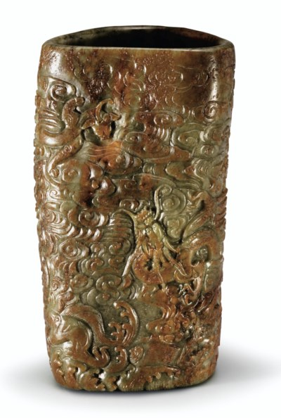 A RARE WELL-CARVED RUSSET AND