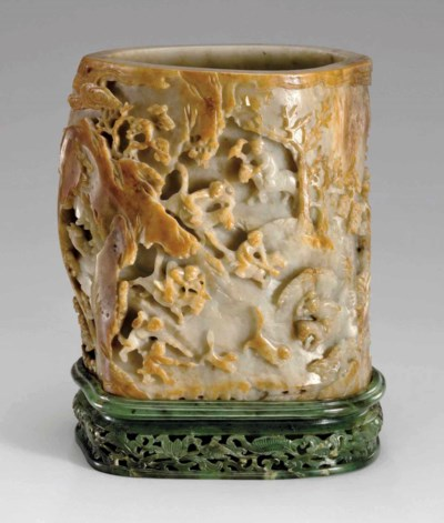 A WELL-CARVED PALE GREENISH-GR