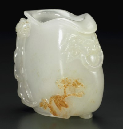A SMALL WHITE JADE POUCH-FORM