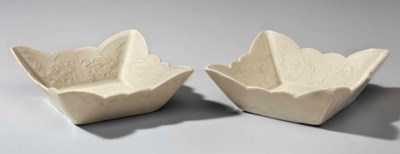 A PAIR OF GLAZED WHITE WARE MO