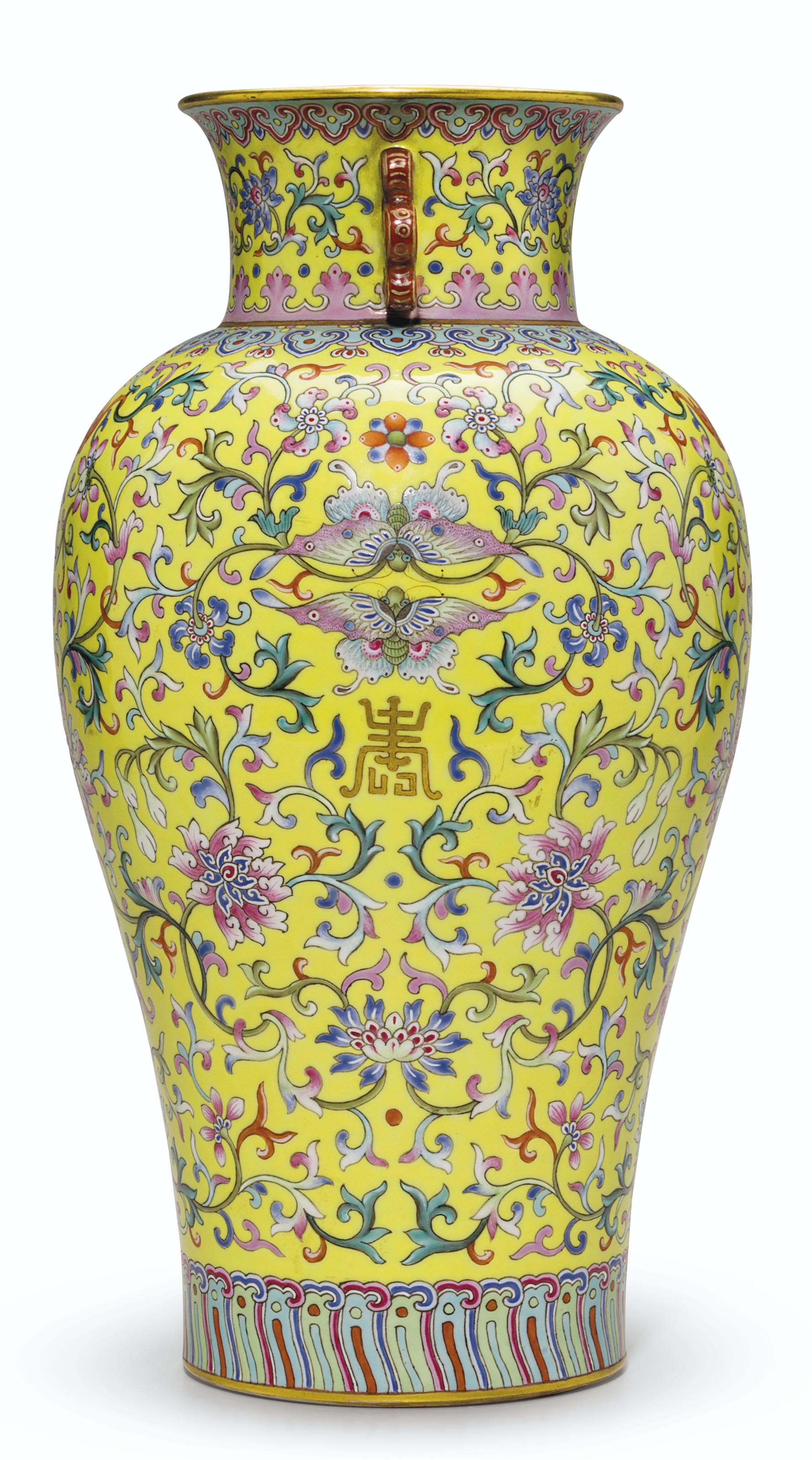 A VERY RARE AND SUPERBLY ENAMELED PAIR OF YELLOW-GROUND FAMILLE ROSE VASES