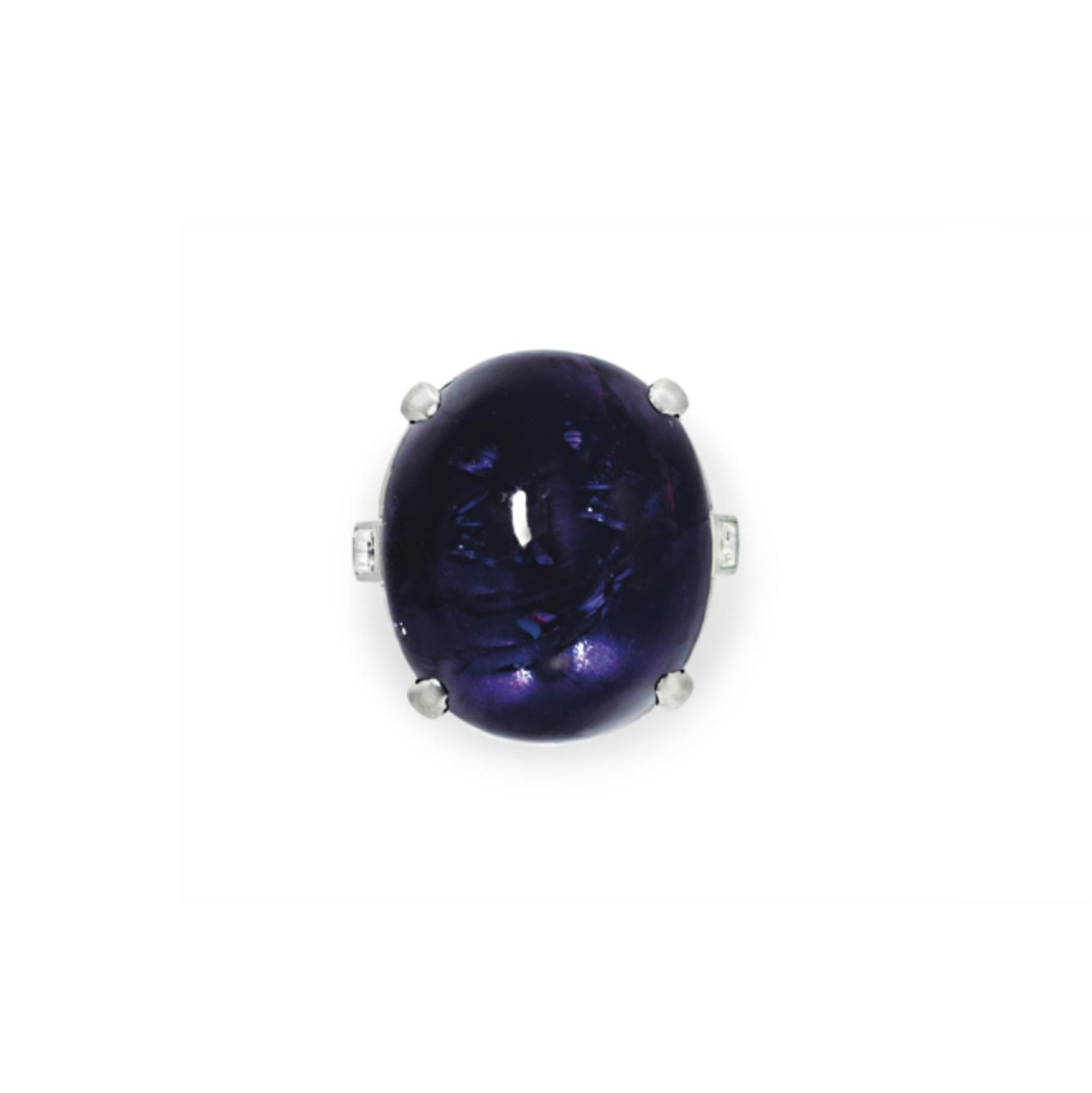 A PURPLE STAR SAPPHIRE AND DIA