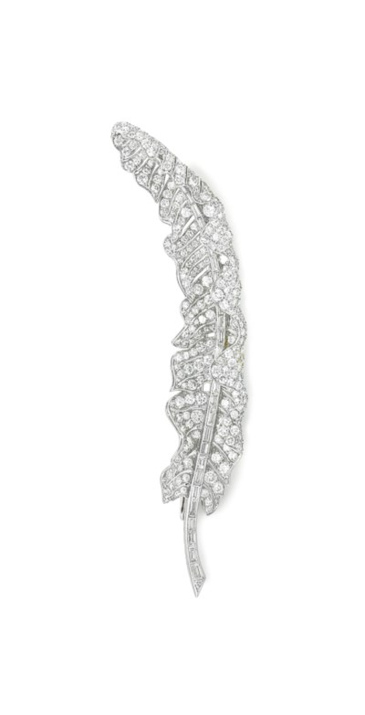 A DIAMOND FEATHER BROOCH