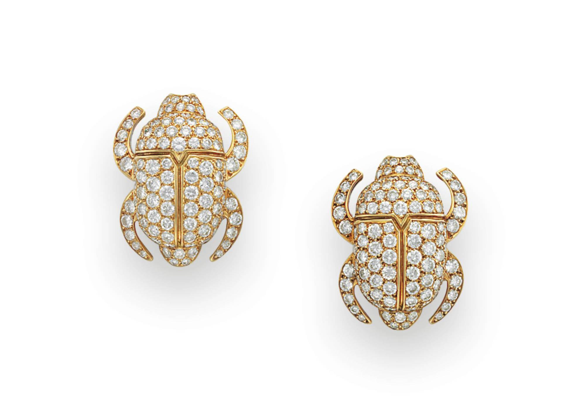 A PAIR OF DIAMOND SCARAB EAR C