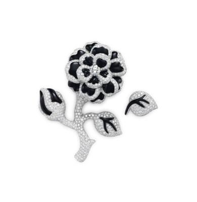 A DIAMOND AND ONYX FLOWER BROO