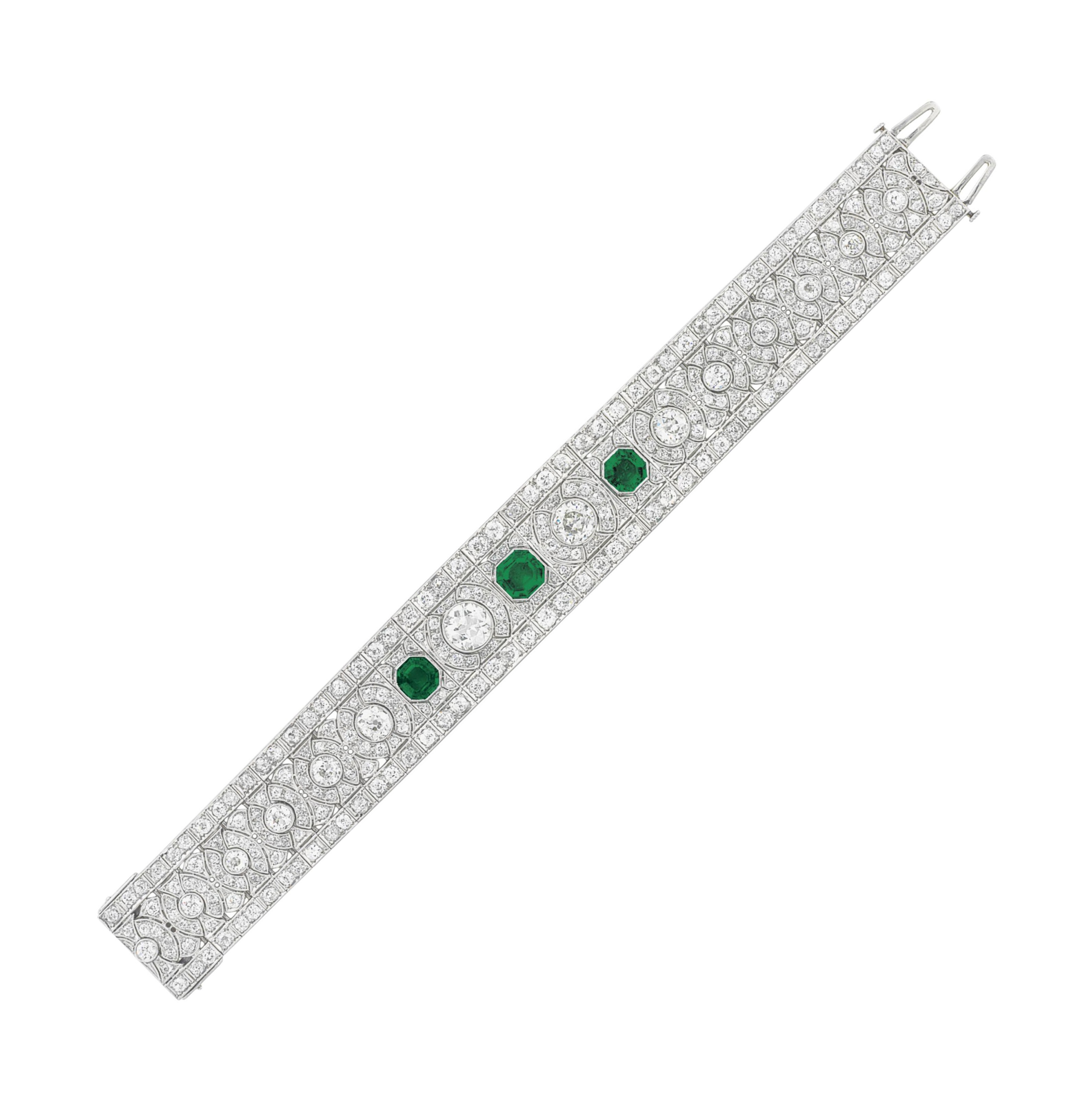 AN ART DECO DIAMOND AND EMERALD BRACELET, BY DREICER & CO.