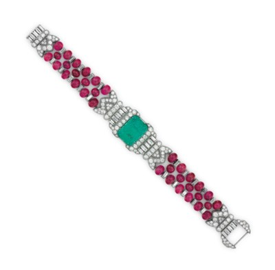 AN ART DECO EMERALD, RUBY AND