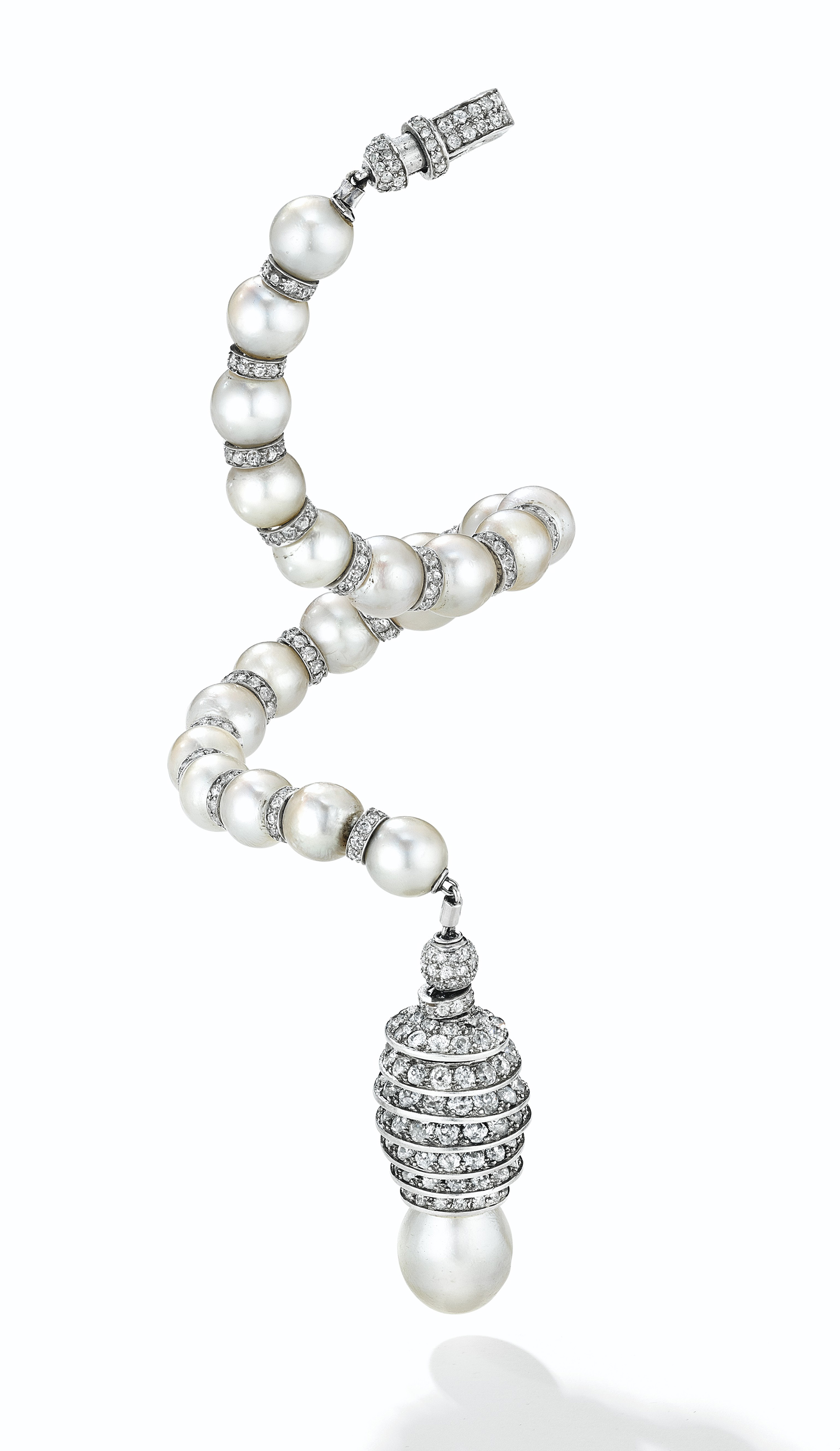 AN ART DECO CULTURED PEARL AND