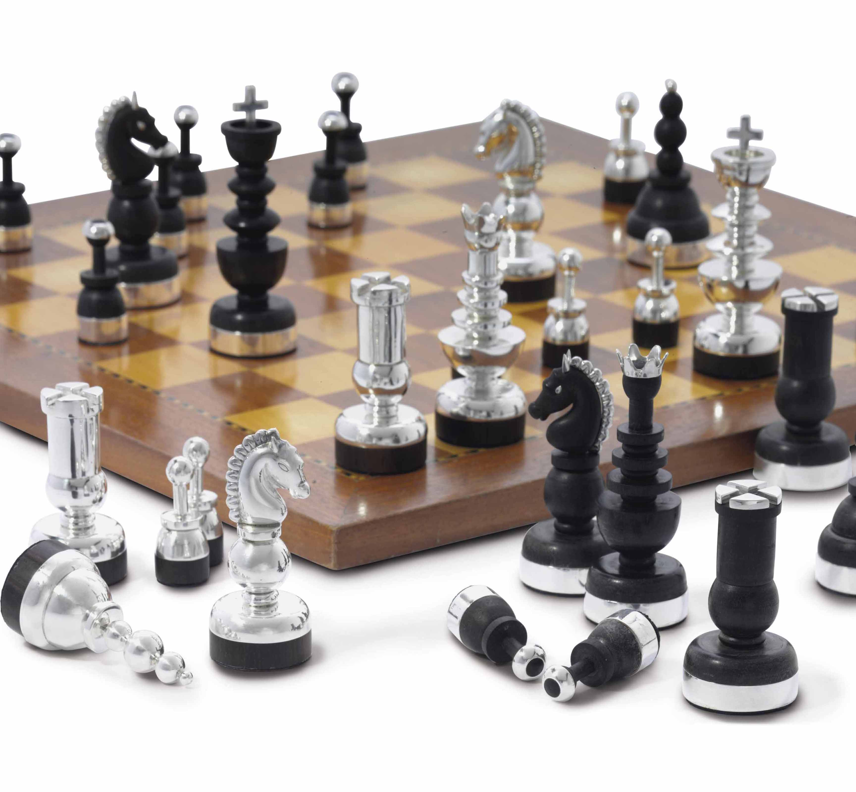 A MEXICAN SILVER-MOUNTED EBONY CHESS SET, DESIGNED BY HECTOR AGUILAR