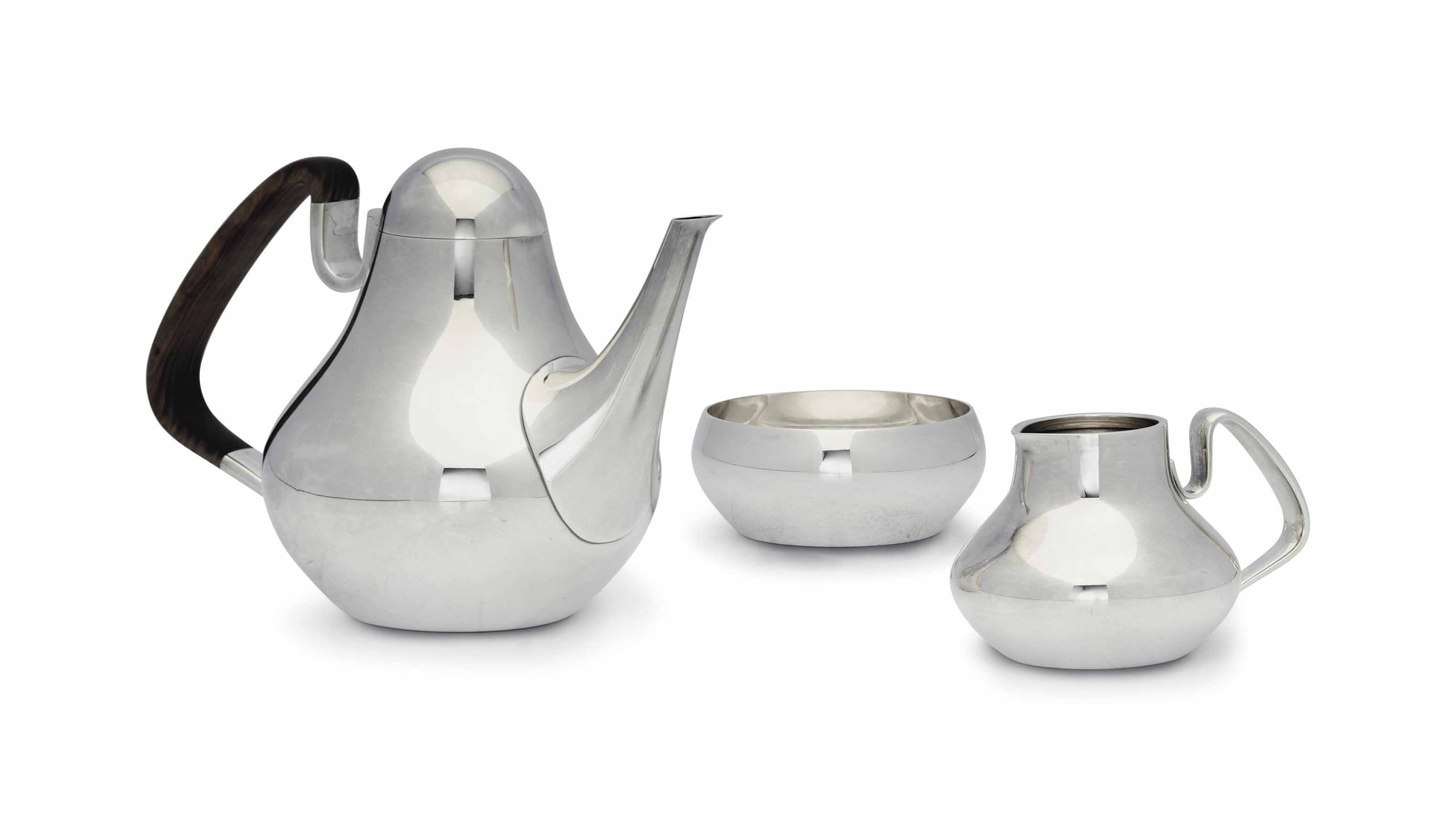 A DANISH SILVER THREE-PIECE TEA SERVICE, DESIGNED BY HENNING KOPPEL