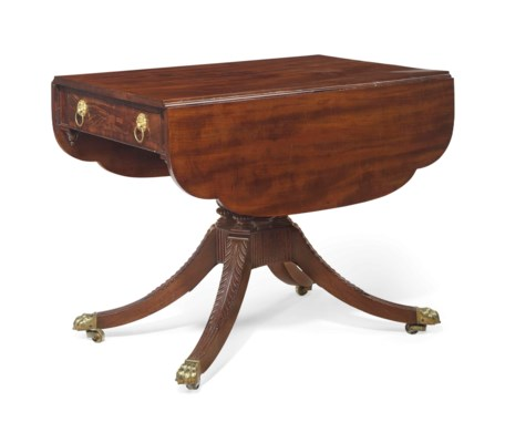 A CLASSICAL CARVED MAHOGANY ON