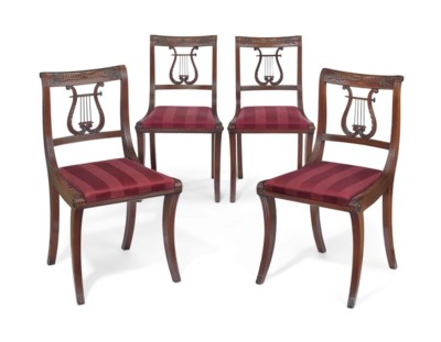 A SET OF FOUR CLASSICAL CARVED