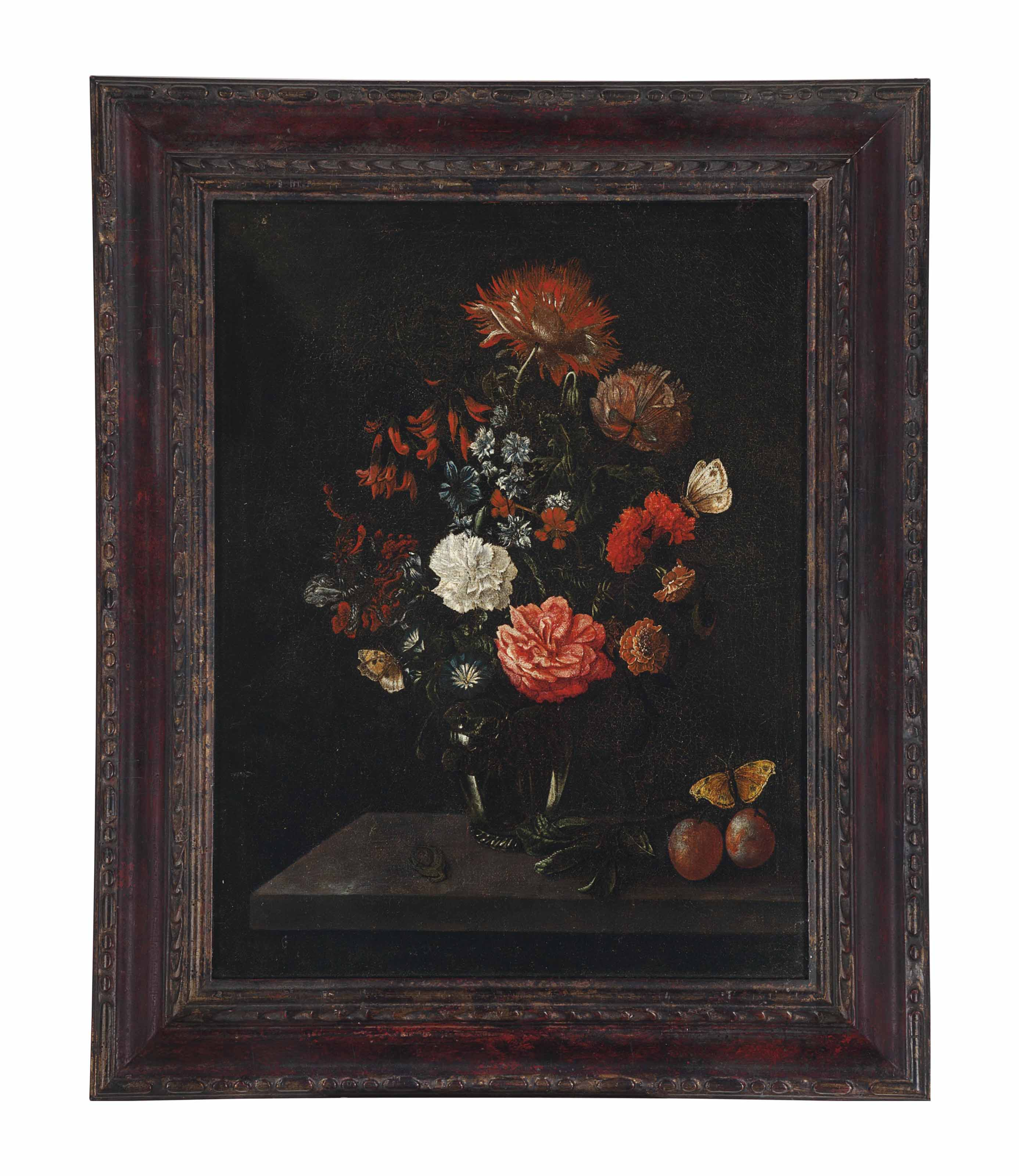 Carnations, roses and other flowers in a glass vase with Italian plums, moths and a lizard on a stone ledge
