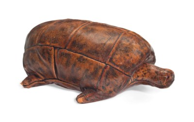 AN ENGLISH COWHIDE LEATHER TUR
