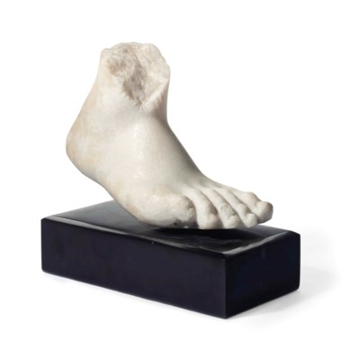 A CARVED MARBLE FOOT FRAGMENT