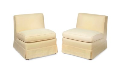 A PAIR OF AMERICAN EASY CHAIRS