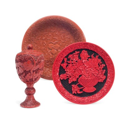A CHINESE CARVED CINNABAR FOOT