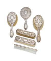 AN EDWARD VII SILVER MOUNTED LADIES DRESSING TABLE SET