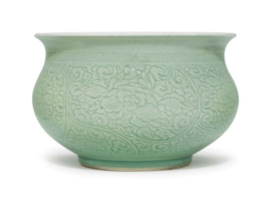 A CHINESE CELADON GLAZED CARVE