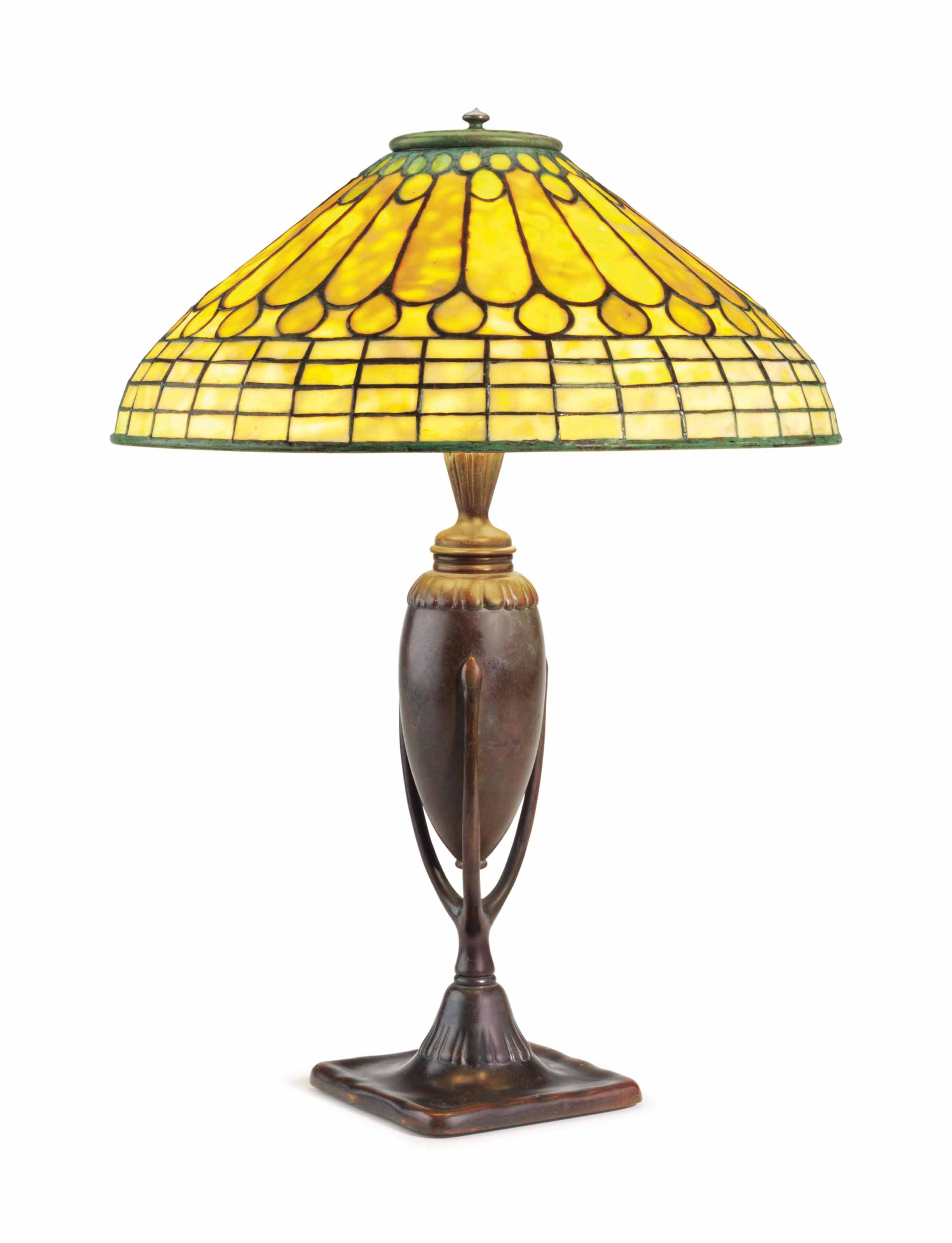 A PATINATED BRONZE TABLE LAMP