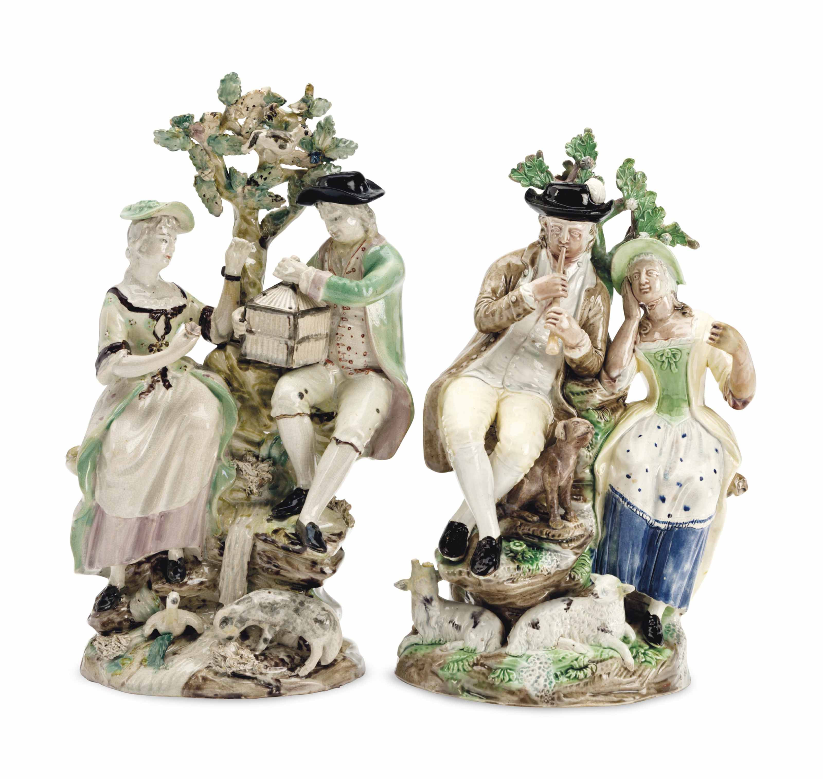 A PAIR OF CREAMWARE FIGURES OF