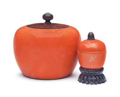TWO ORANGE-GROUND CERAMIC JARS
