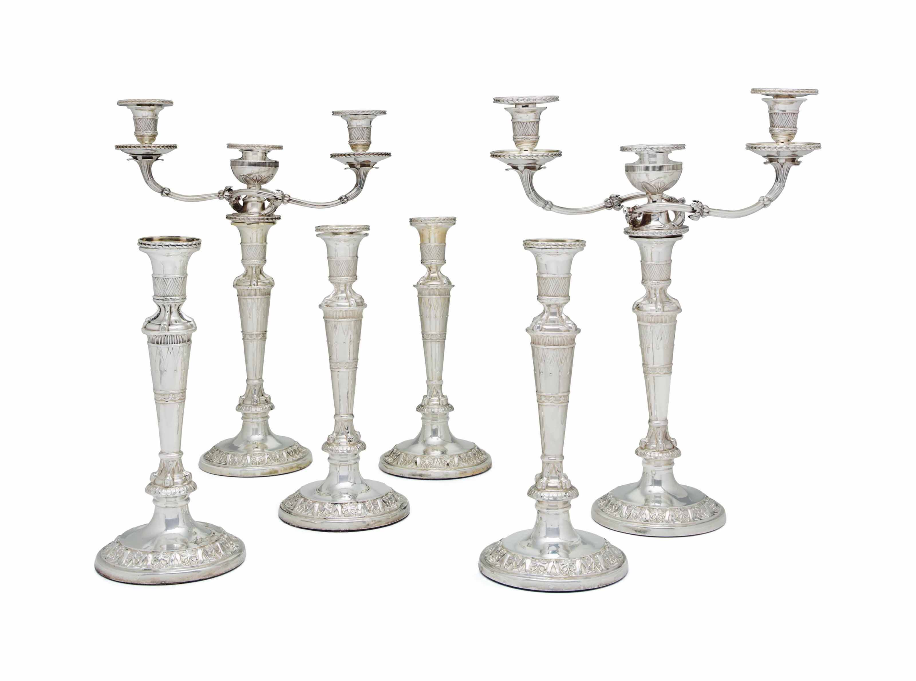A PAIR OF GEORGE III SILVER THREE-LIGHT CANDELABRA AND A SET OF FOUR GEORGE III SILVER CANDLESTICKS EN SUITE