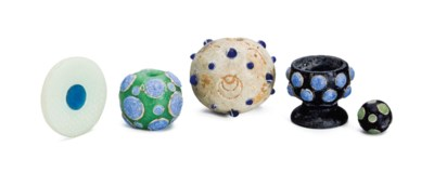 THREE MOLDED GLASS BEADS, A ST