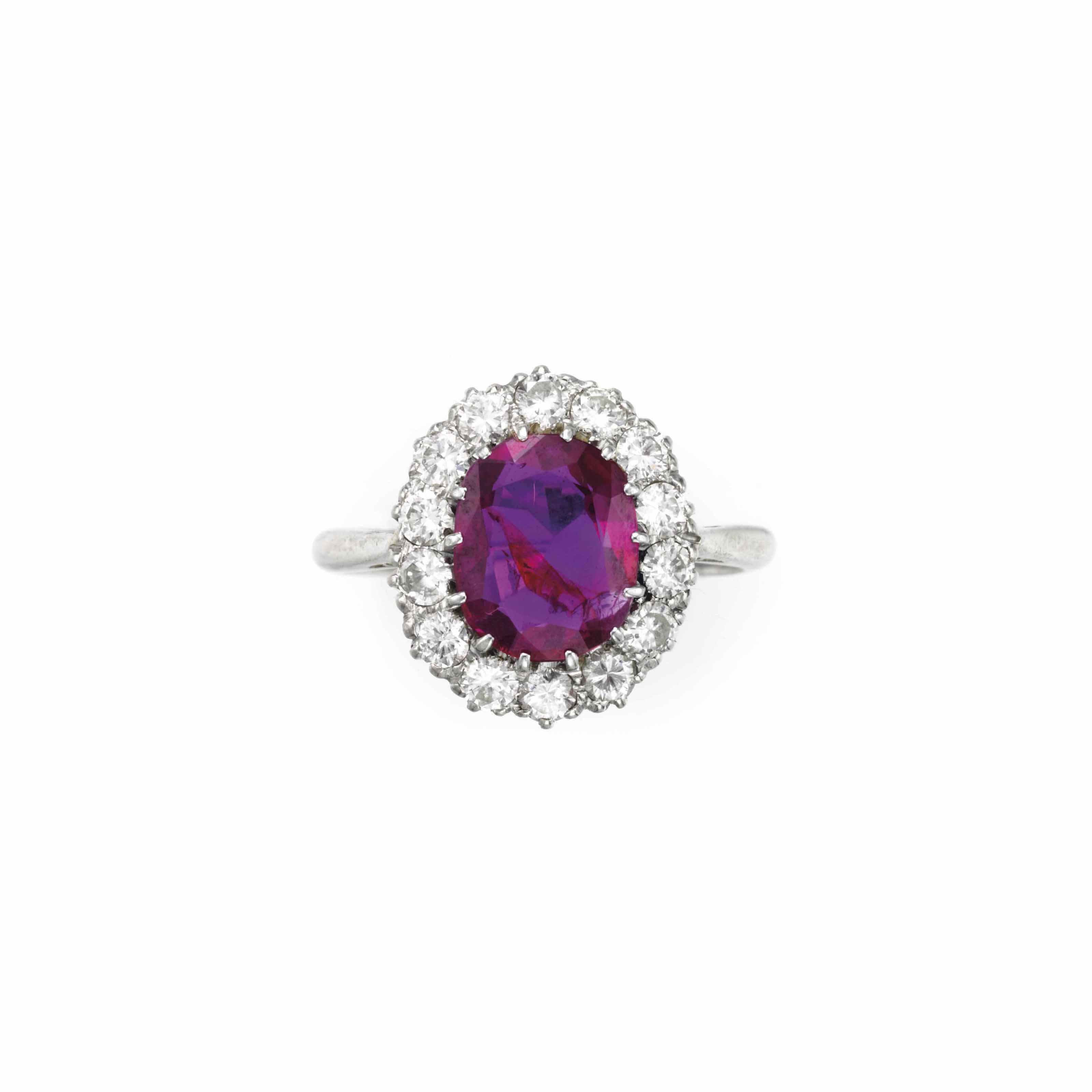 A PLATINUM, OVAL-CUT RUBY, AND