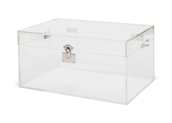 A METAL-MOUNTED LUCITE TRUNK
