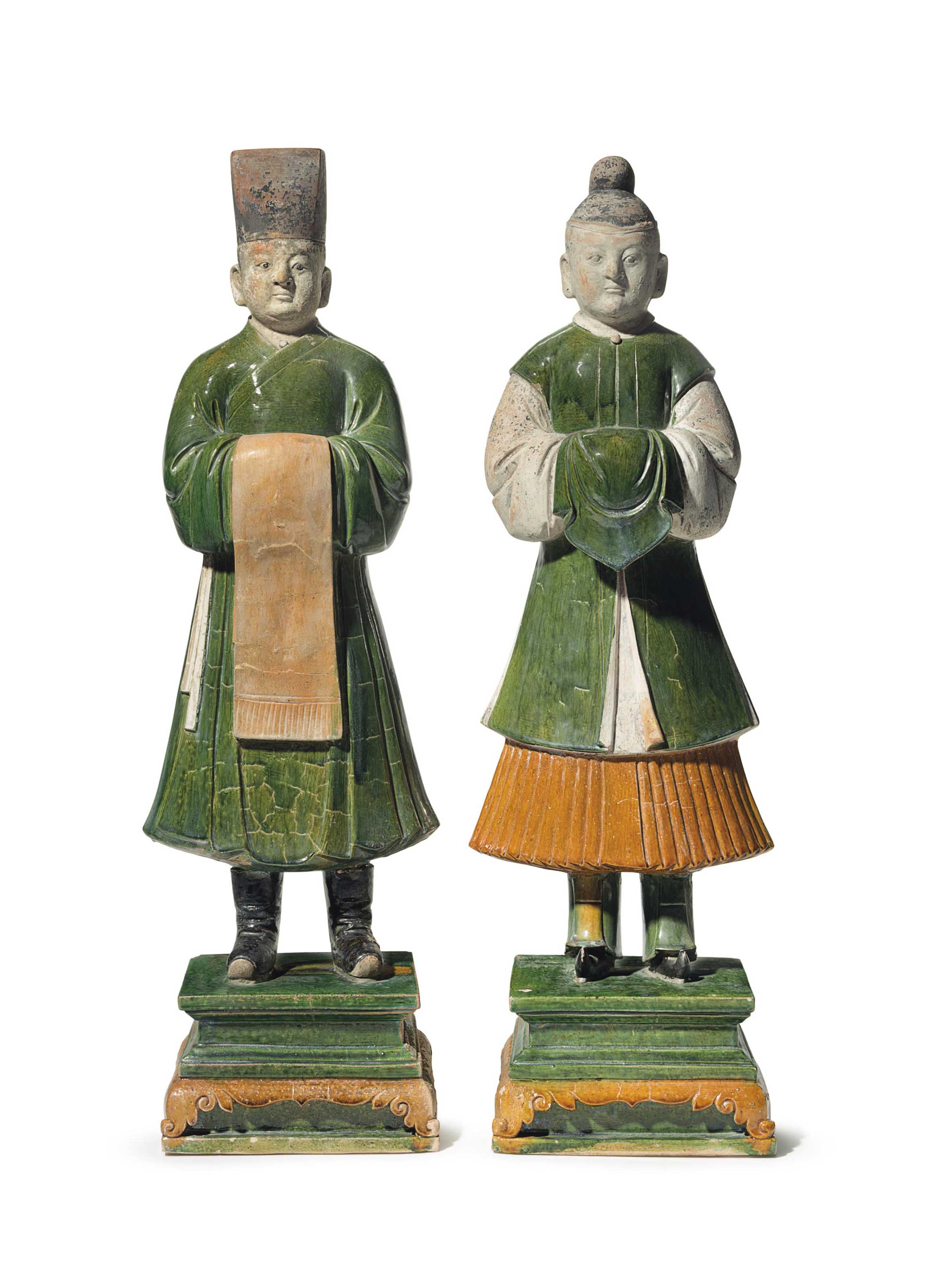 A PAIR OF CHINESE LARGE GREEN AND AMBER-GLAZED TILEWORKS FIG...