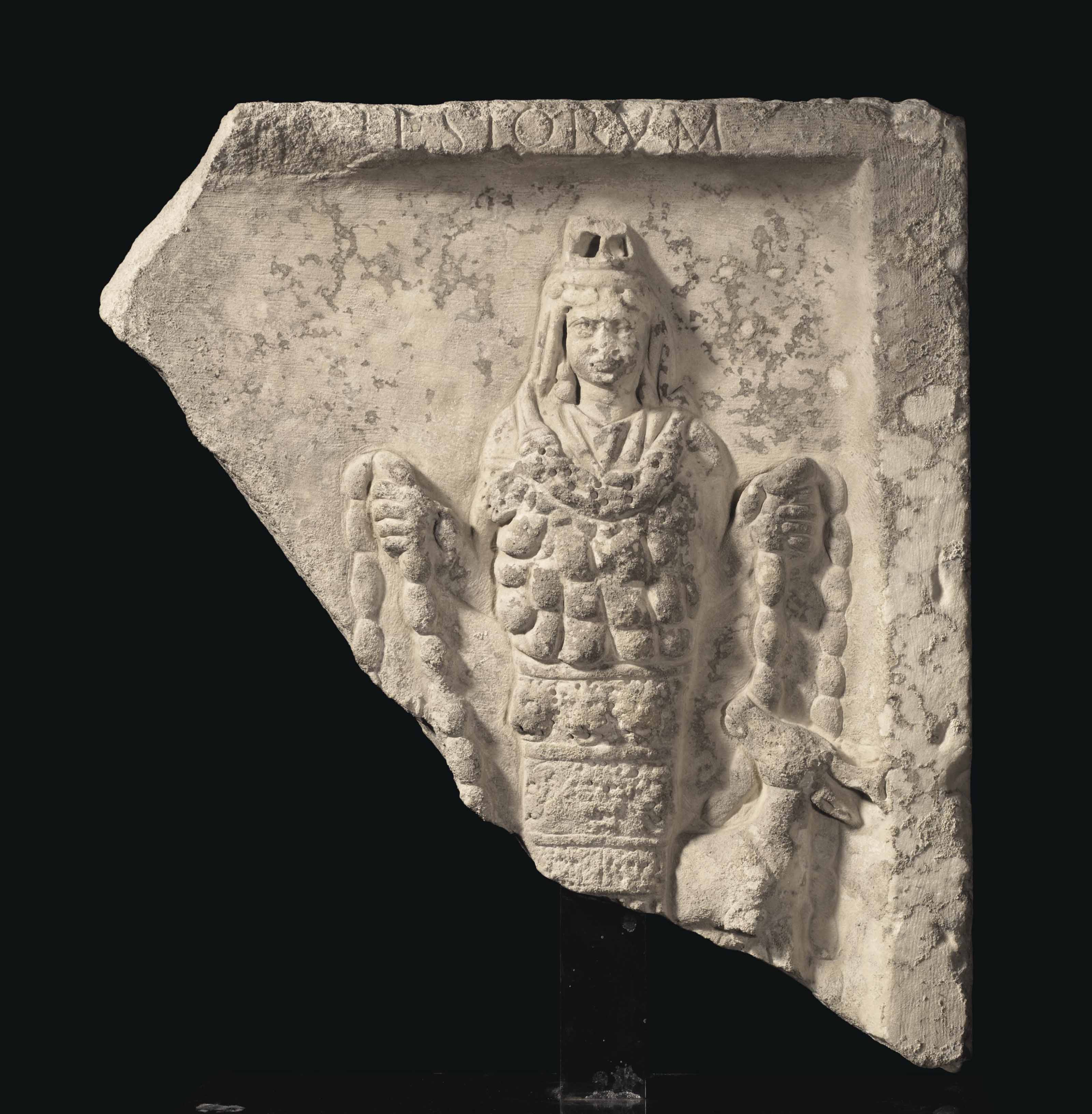 A ROMAN MARBLE RELIEF OF ARTEMIS OF EPHESUS