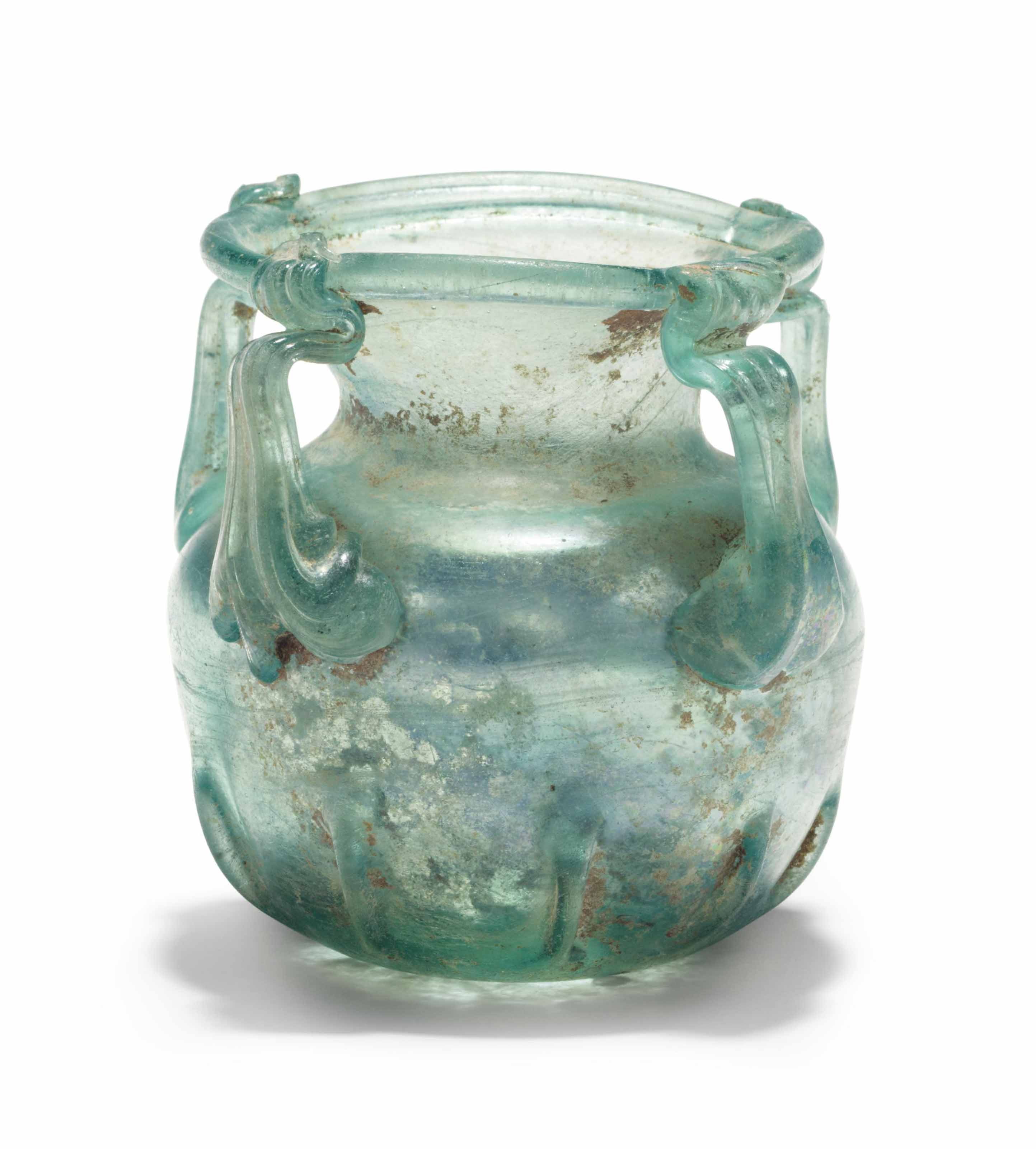 A LATE ROMAN GLASS FOUR-HANDLED JAR