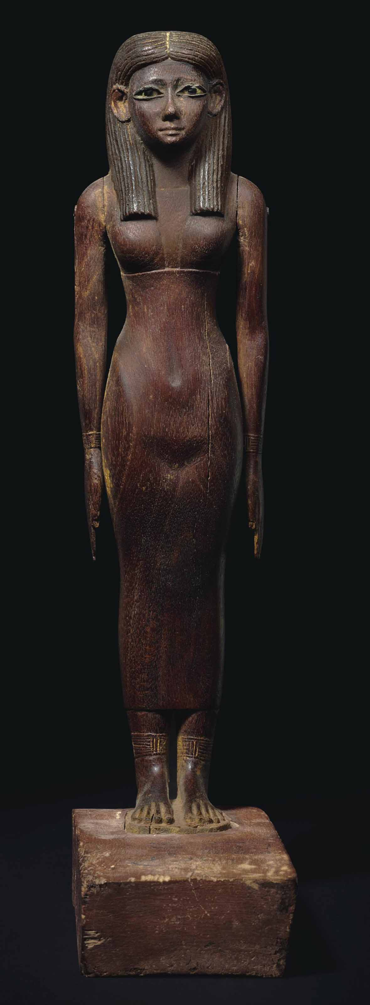 AN IMPORTANT EGYPTIAN WOOD FIG