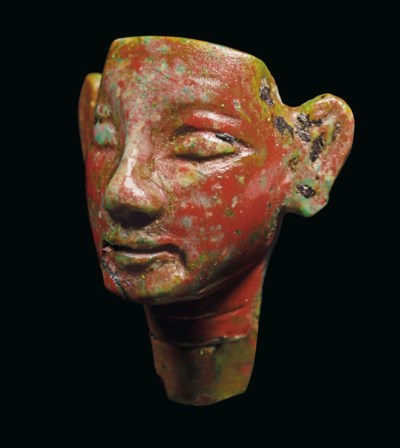 AN EGYPTIAN RED GLASS ROYAL HE