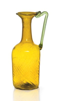 A ROMAN MOLD-BLOWN AMBER GLASS