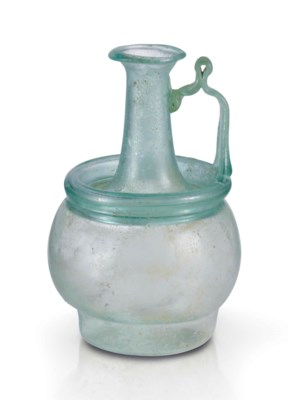 A ROMAN PALE GREEN GLASS JUG