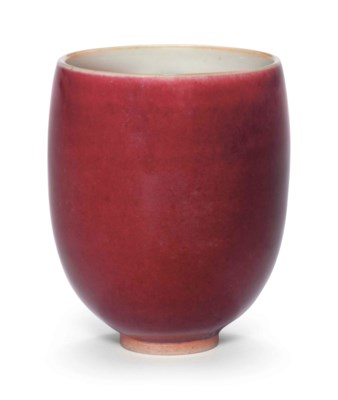 A COPPER-RED-GLAZED CUP