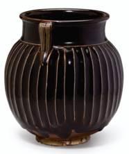 A BLACK-GLAZED RIBBED JAR