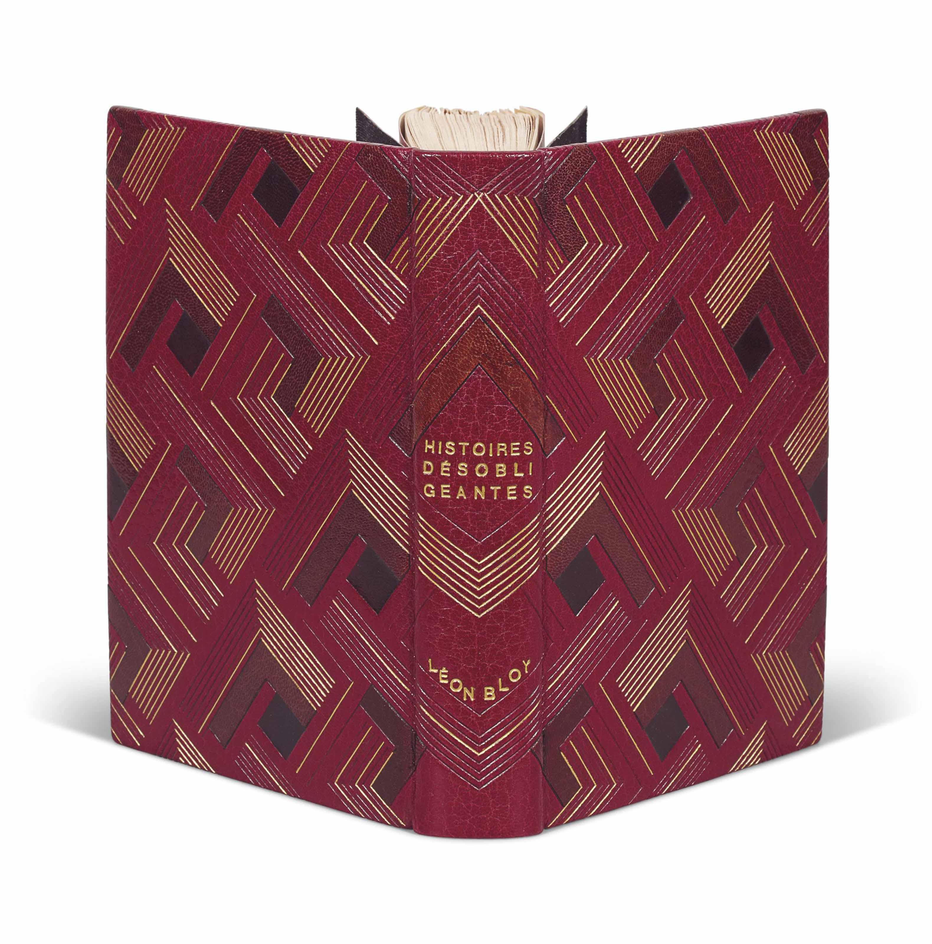 Léon BLOY (1846-1917). Histoires désobligeantes. Paris, E. Dentu, [1894]. In-12 (193 x 130 mm). Reliure signée de Pierre Legrain, maroquin rouge corinthe mosaïqué de bandes de maroquin aubergine et de carrés de maroquin noir en creux, décor géométrique doré et à froid se poursuivant d'un plat sur l'autre, dos lisse, titre et nom de l'auteur dorés, doublure et gardes de soie tissée d'or, couverture et dos conservés, non rogné, chemise et étui (infime déchirure de 3 mm restaurée au plat inférieur de couverture, dos très légèrement passé).