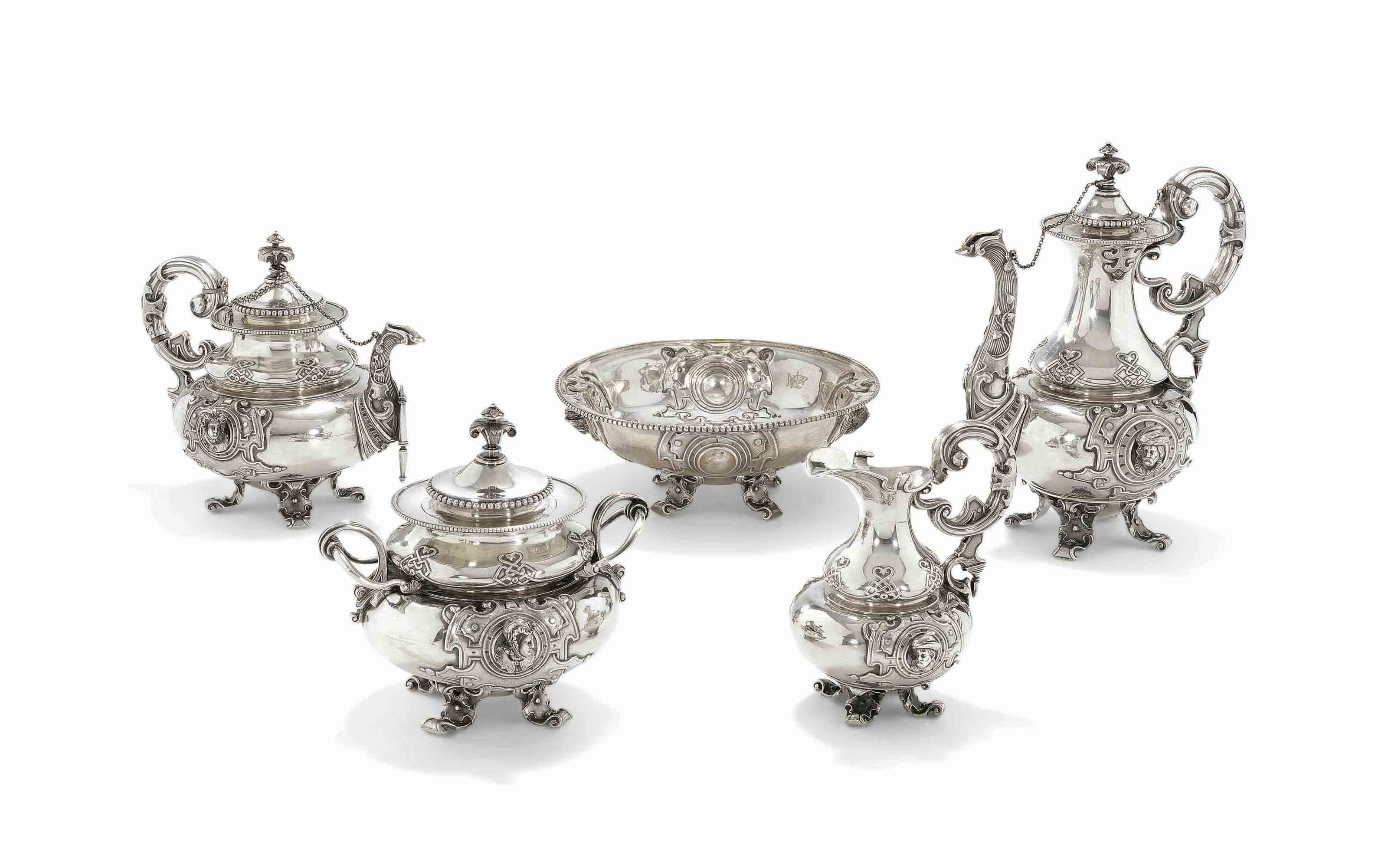 AN UNUSUAL PARCEL-GILT SILVER TEA AND COFFEE SERVICE