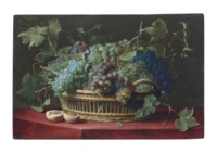 A basket of grapes with a halved peach on a ledge