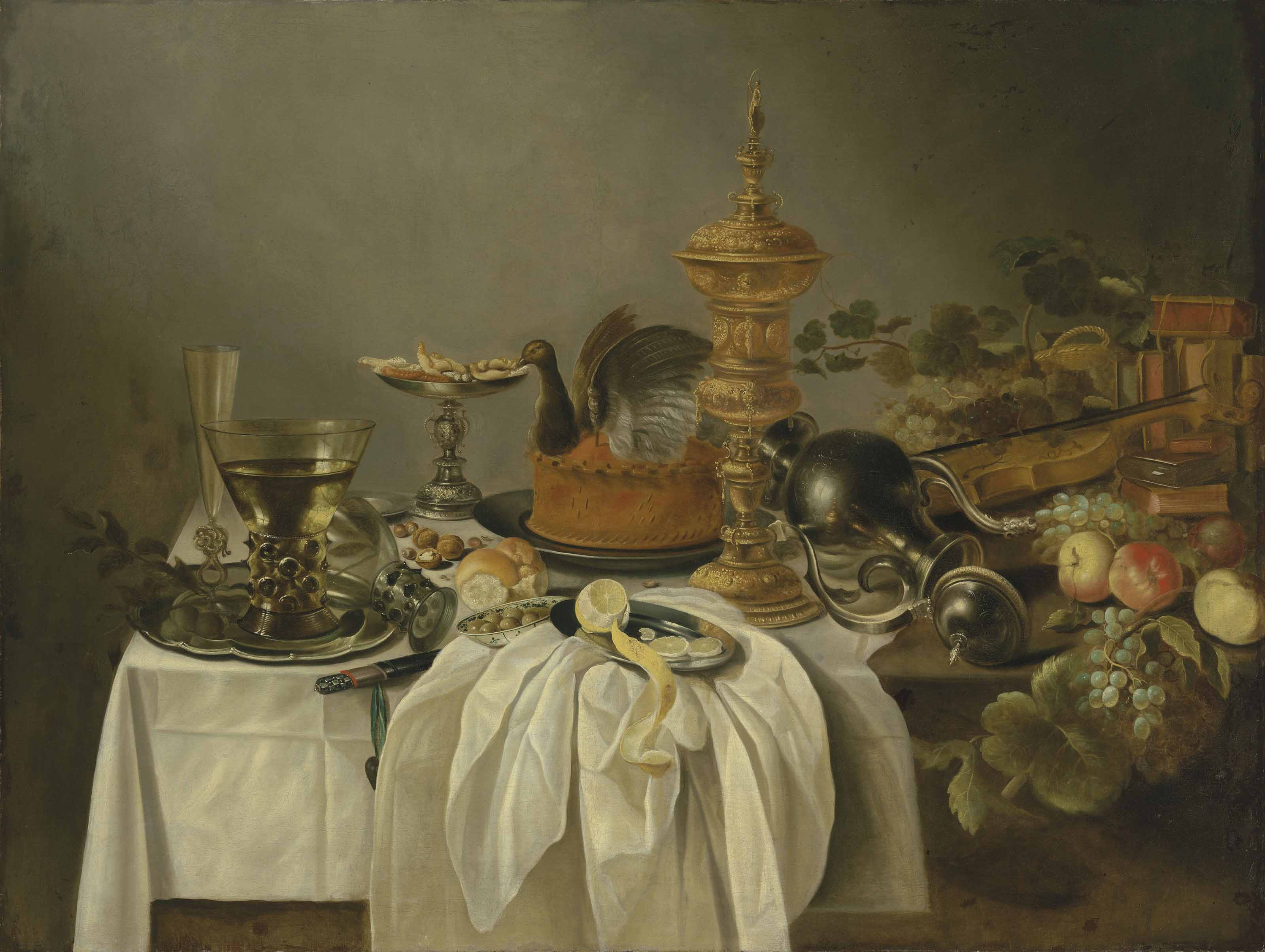 A pewter jug, a game pie, a silver tazza, roemers and a façon-de-Venise flute on a pewter platter, with a partly-peeled lemon, a dish of olives, and other fruit, on a partially draped table