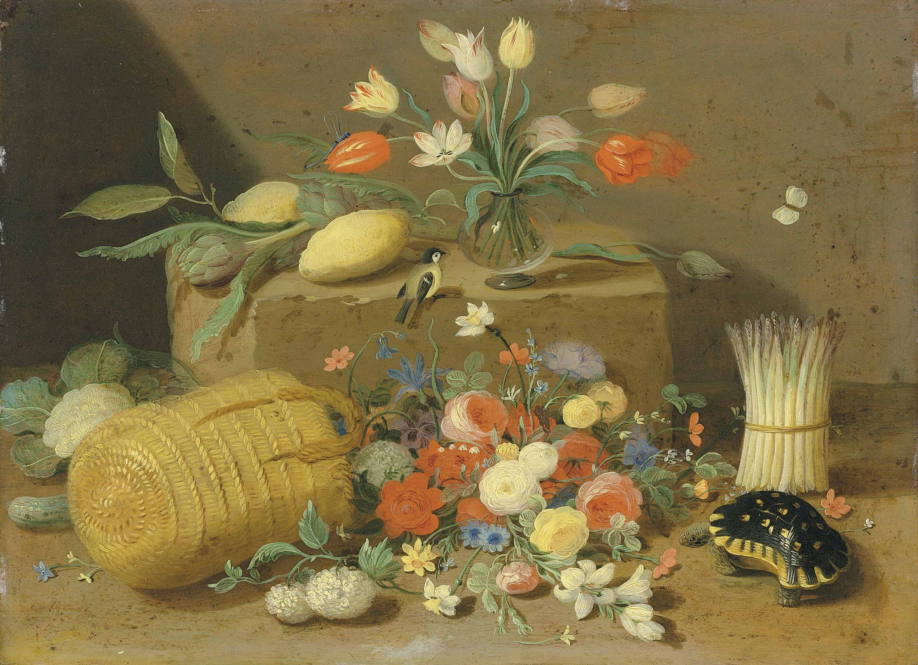 An overturned basket of flowers with a tortoise